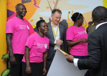 MTN Uganda CEO Wim Vanhelleputte flanked by Rays of Hope Hospice mothers at MTN head office in Kampala (PHOTO/PML Daily)