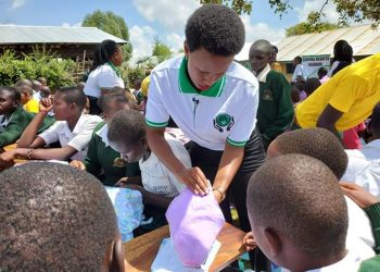 Ms. Berbie Kyagulanyi teaches young girls how to make reusable sanitary towels (PHOTO/PML Daily)