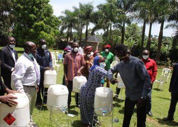 The Kyadondo East legislator demonstrates elbow-greeting after  distributing handwashing kits to his constituency leaders on Sunday (PHOTO/Courtesy).