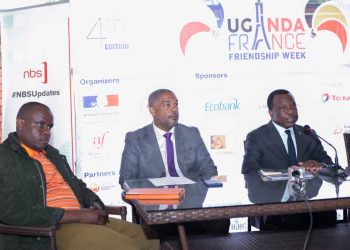 H. E.  Jules - Armand Aniambossou , the French Ambassador to Uganda addressing the media at the French Embassy  on Monday , March 16,  flanked by William Blick and  Balaam Barugahara, the Proprietor of Balaam Marketing Agency respectively ( Photo / Abraham).