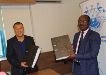 NWSC MD Dr. Eng Silver Mugisha and  Zhonghao Overseas Construction Eng.Co.Ltd representative Wang Feifei (PHOTO/Courtesy).