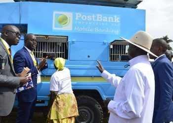 President Museveni(in cap), Mr. Julius Kakeeto(R), MD, Post Bank, Mr. Albert Barekye(2R), General Manager Operations, Post Bank and Hon. Frank Tumbwebaze(L), Gender Minister inspect a Post Bank mobile van used to serve the elderly, during Women's day celebrations at Malukhu grounds, Mbale district on Sunday (PHOTO/PML Daily).
