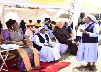 Speaker Rebecca Kadaga listens in form a nun under congregation of the Missionary Sisters of the Queen of Apostles in Uganda, during Women's Day celebrations in Masese (PHOTO/PML Daily)