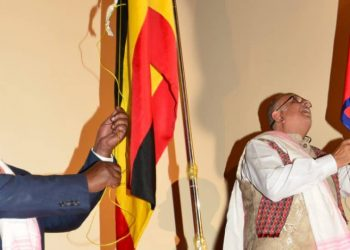 Foreign Affairs Minister Sam Kutesa and His Excellency Dr. Sudhir Ruparelia hoist the Ugandan and Nepalese flags during the inauguration of the Nepal consulate in Kampala on Tuesday (PHOTO/Courtesy).
