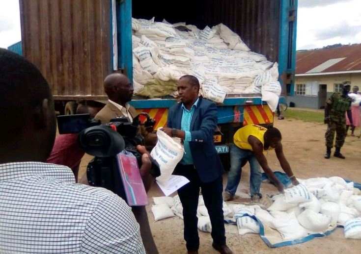 Hon. Gerald Karuhanga of Ntungamo municipality handing over the donated food to the district taskforce (PHOTO/Courtesy).