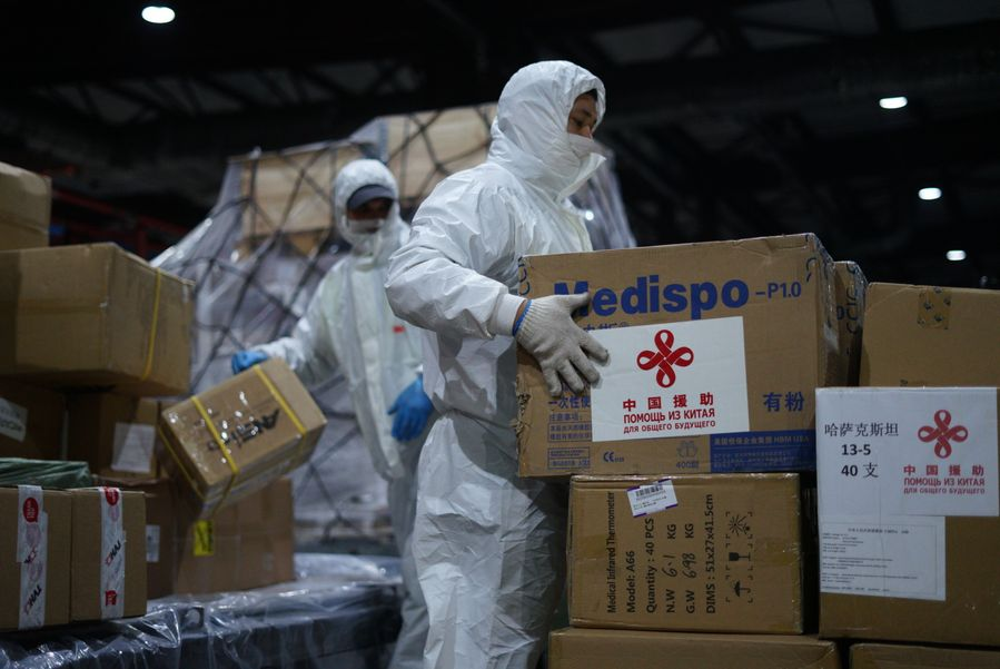 Workers transfer medical supplies from China in a warehouse at the Almaty International Airport in Almaty, Kazakhstan, April 2, 2020. (Kursiv Newspaper/Handout via Xinhua)