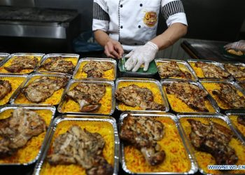 Free meals for low-income people are prepared in a restaurant during COVID-19 outbreak in Cairo, Egypt, April 4, 2020. Egyptian Health Ministry confirmed on Tuesday 128 new COVID-19 cases and nine deaths, bringing the total infections in the country to 1,450. (Xinhua/Ahmed Gomaa)