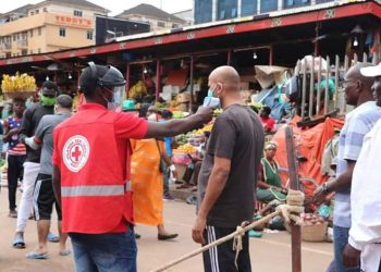 Uganda Red Cross rolled out COVID19 Screening and  Risk communication in high risk places including markets around Kampala (PHOTO/Courtesy)