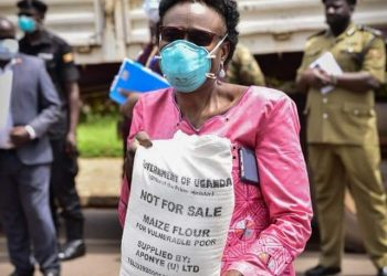 Health Minister Jane Ruth Aceng holding a sack of maize floor (PHOTO/Nicholas Bamulanzeki).
