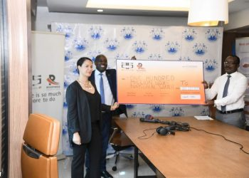 Nashila Lalani from the @Roofings_Group handing over 100M contribution to NWSC MD Dr. Eng Silver Mugisha to install bulk water points aimed at supplying water to water stressed areas of Kampala during the COVID19 outbreak.