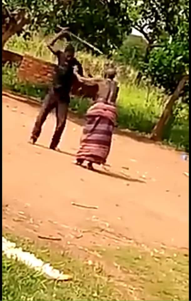 Man pictured caning old woman in Omoro district (PHOTO/Courtesy).