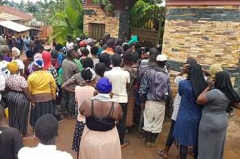 People gathered at Kampala Lord Mayor Erias Lukwago's gate