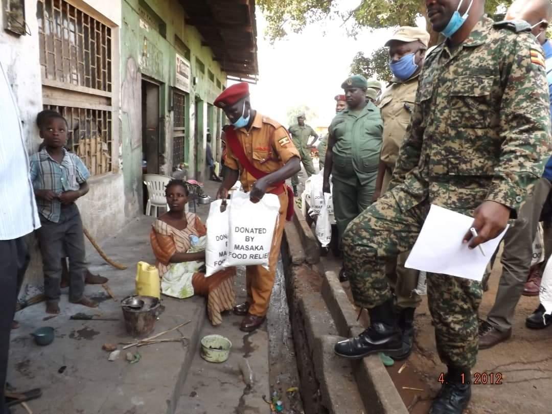 Coronavirus taskforce members distributing food in Masaka in district (PHOTO/Courtesy).