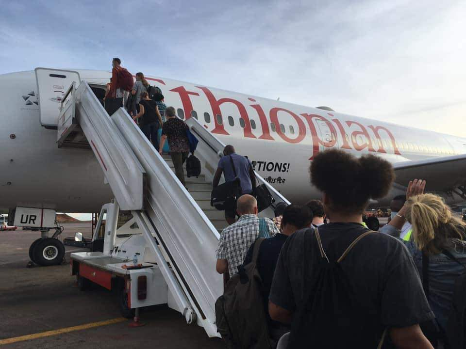 Some of the repatriated foreign nationals board an Ethiopian Airlines flight at Entebbe (PHOTO/Courtesy).