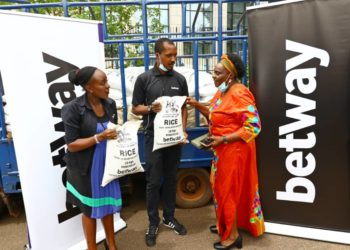 Betway Country Manager Adellah Agaba (L) and Marketing Manager Clive Kyaze (C) handing over the rice on Tuesday. (PHOTOS/Courtesy)