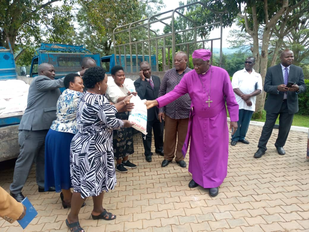 Bishop of West Ankole Diocese, Rt. Rev. Johnson Twinomujuni (R) handing over the donated food to the Taskforce (PHOTO/PML Daily).