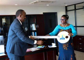Ms. Doris Akol has handed over office to URA commissioner general John Musinguzi (PHOTO/Courtesy)