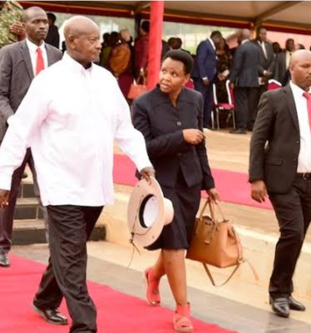 State House Anti-Corruption Unit, Lt Col Edith Nakalema whispers to President Museveni (PHOTO/File).