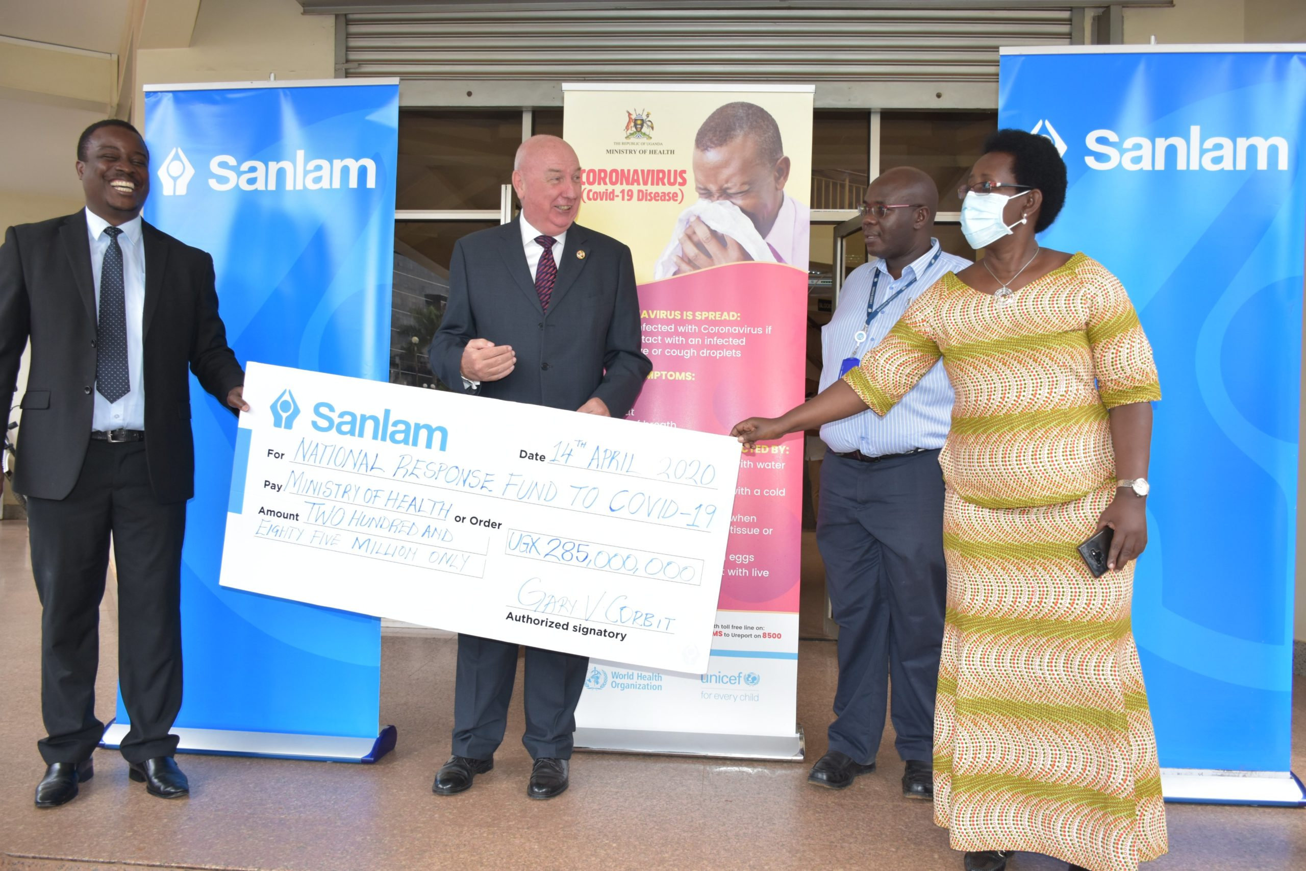 Permanent Secretary, Diana Atwine has received a dummy cheque worth UGX 285 M from sanlam to support the National Response COVID-19 fund (PHOTO/Courtesy)
