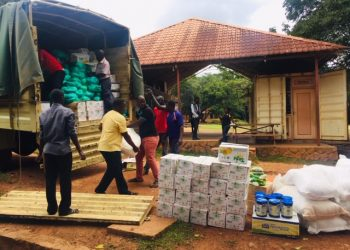 Some of the relief food being off loaded from the truck (PHOTO/Elizabeth Namajja)