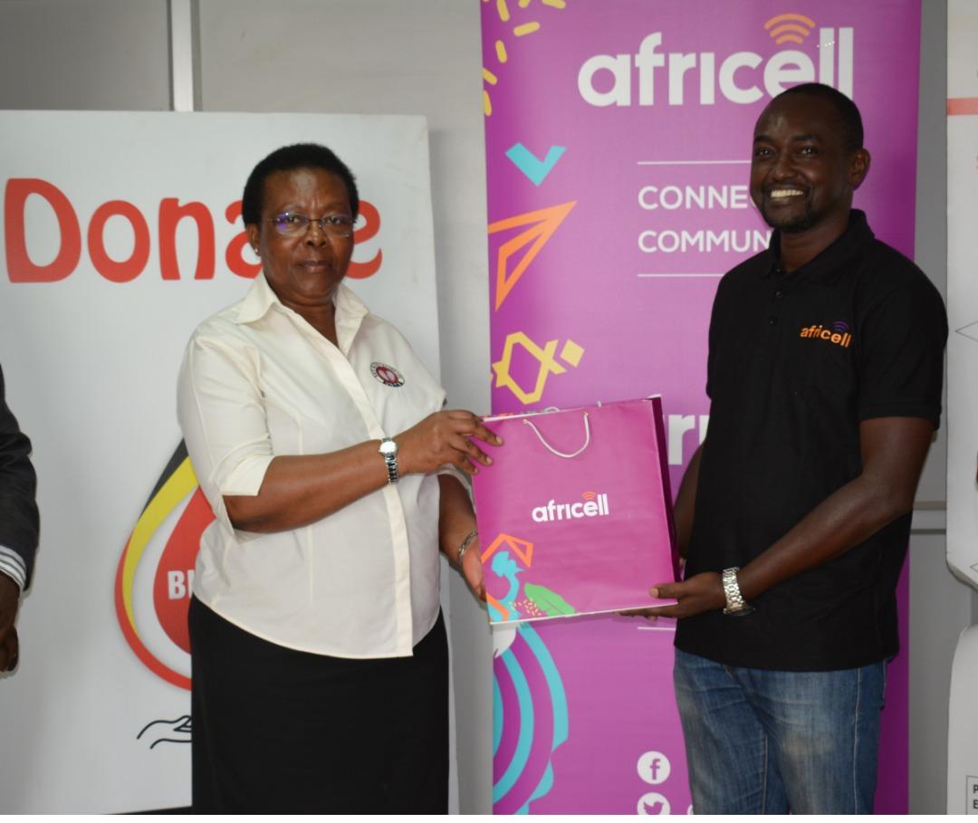 (L -R) Dr Dorothy Nakyeyune UBTS ED receives Donation from Africell PRO Edgar Karamagi (PHOTO/Courtesy)