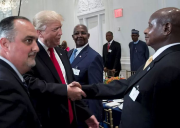 Presidents Museveni (R) and Trump shake hands (PHOTO/File).
