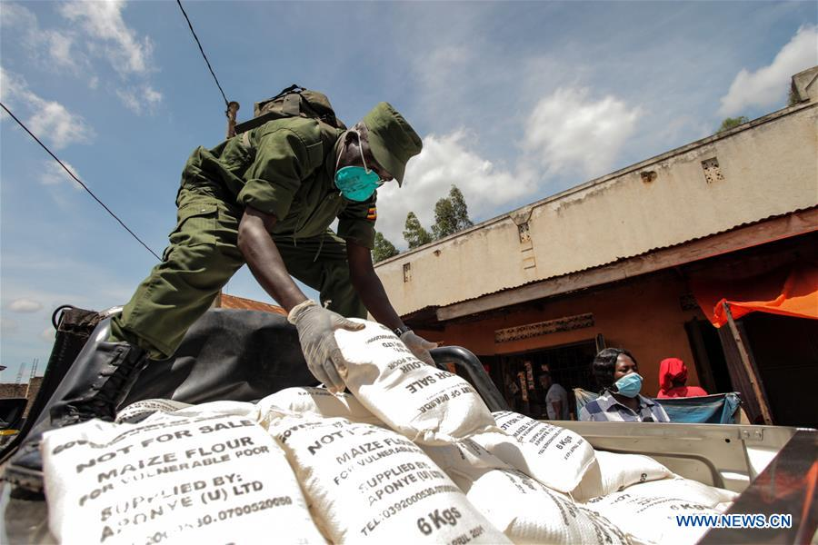 A military officer arranges bags of maize flour during the relief food distribution in Kampala, capital of Uganda, April 4, 2020. Uganda on Saturday started relief food distribution to about 1.5 million urban poor who are affected by the lockdown as a measure to contain the COVID-19 outbreak in the country. (Photo by Hajarah Nalwadda/Xinhua)