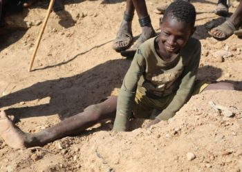 A school going child also at Katikekire digging through the soils to find some Gold.David Mafabi