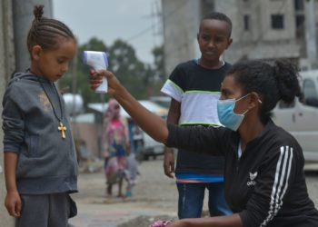 A health worker (R) carries out a door-to-door temperature screening in order to control the spread of COVID-19, in Addis Ababa, capital of Ethiopia, April 20, 2020. (Xinhua/Michael Tewelde)