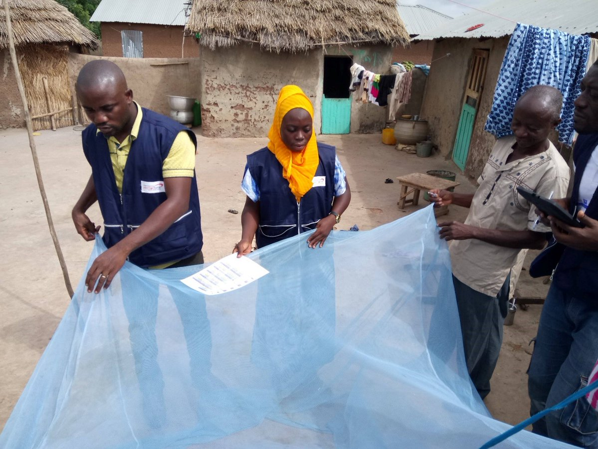 VectorLink Project workers demonstrate to the locals how to use a mosquito net (PHOTO/Courtesy).
