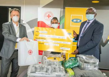 Mr. Wim Vanhelleputte (R), the MTN Uganda company boss handing over the donated items including cheque to Kasese district Officials on Monday (PHOTO/Courtesy).