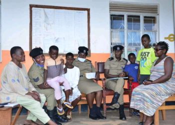 Police officers in a photo with the rescued children (PHOTO/Courtesy).