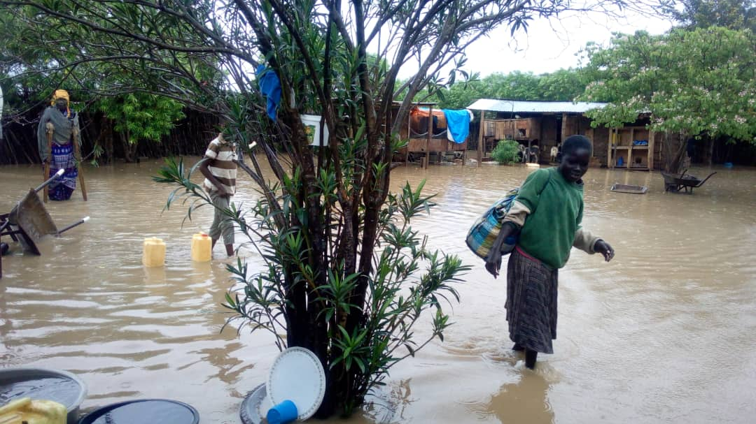 The photo of residents weeding through their flooded houses in Kangole after the downpour (Photo by Jonathan Opolot