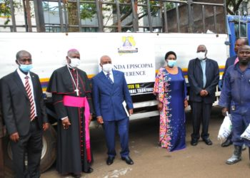 Officials from the Catholic Church led by the Chairman of the bishops conference Joseph Antony Zziwa handover donations to the Minister for General Duties Mary Karooro Okurut (PHOTO/Courtesy).