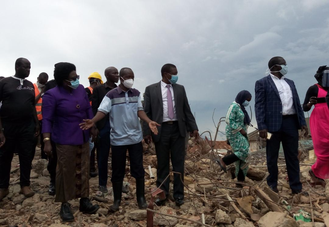 (L - R )  Hon. Betty Amongi, the Minister for Kampala, the local chairperson of the village and Mr.Andrew Kitaka, the Ag. Executive director of Kampala Capital City Authority ( KCCA) at the  site in Kiwempe , in Makindye Division (Photo  /Abraham Mutalyebwa)