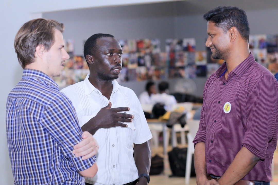 Caption: HiPipo CEO Innocent Kawooya (centre) with Modusbox's Architect Sam Kummary (right) and Crosslake Technologies developer Lewis William Daly (Left) during the Hack Mojaloop event in Kampala last year.