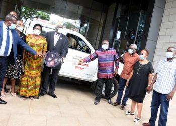 Businessman Kirumira handsover the key brand new pick-up truck (Abraham Mutalyebwa)