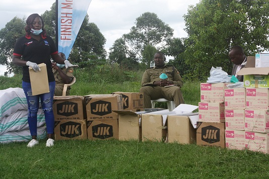Ms Teo Namata (L), the Project Manager Amref Health Africa handing over the medical kits on Thursday to Bunyangabu district Covid 19 taskforce (PHOTO/PML Daily)