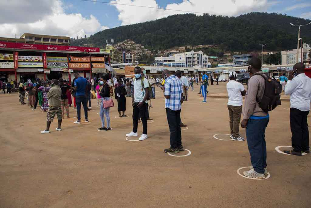 Passengers wait at a bus station with signs of social distancing on the ground in Kigali, Rwanda, May 4, 2020. (Xinhua/Cyril Ndegeya)