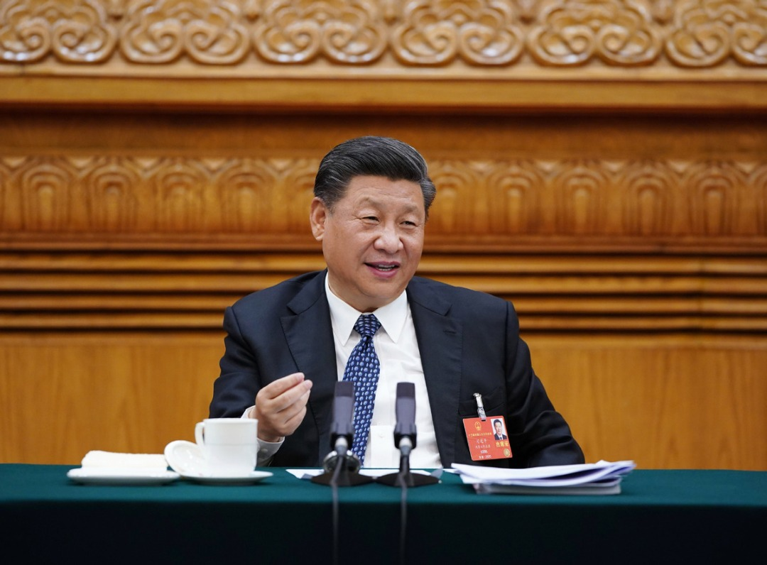 President Xi Jinping, also general secretary of the Communist Party of China Central Committee and chairman of the Central Military Commission joins a deliberation with deputies from Hubei province at the third session of the 13th National People's Congress, China's top legislature, in Beijing, May 24, 2020.  ?Photo/Xinhua?