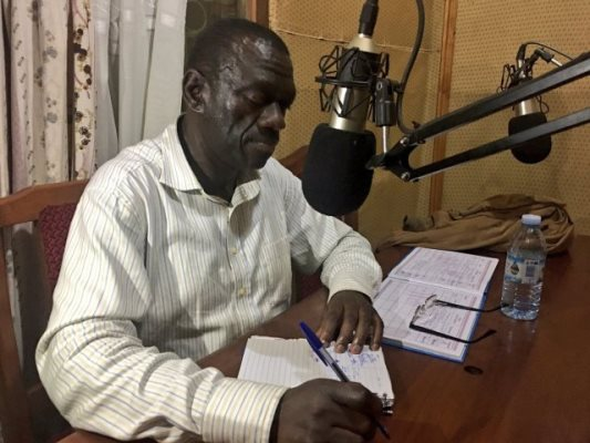 Dr Kizza Besigye being hosted in one of the radio stations recently (PHOTO/File).