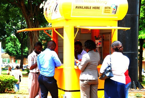 Mobile Money users que up at an agent for the service. MTN Uganda has restored sending charges  (PHOTO/File).