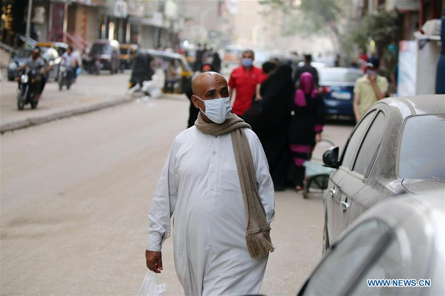 A man wearing a face mask walks on a street in Cairo, Egypt, on May 22, 2020. Egypt recorded 783 new COVID-19 cases during the last 24 hours, the highest daily rise since the pandemic outbreak in February, bringing the total cases to 15,786, Egypt's health ministry said on Friday. (Xinhua/Ahmed Gomaa)