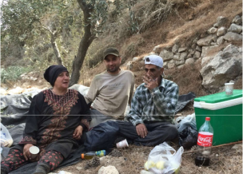 Ghassan al-Najjar, a Palestinian farmer from the northern West Bank village of Burin seated with his parents (PHOTO/Courtesy).