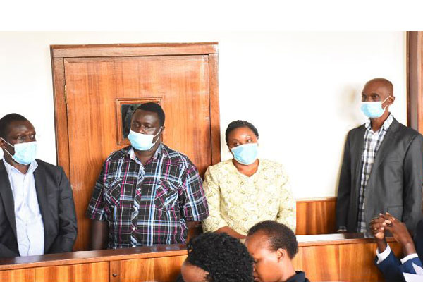 Charged. Left to right: Mr Martin Owor (Commissioner disaster preparedness), Mr Joel Wanjala (accounting officer), Ms Christine Guwatudde (OPM Permanent Secretary), and Mr Fred Lutimba (assistant commissioner, procurement) appear before Buganda Road Court yesterday
