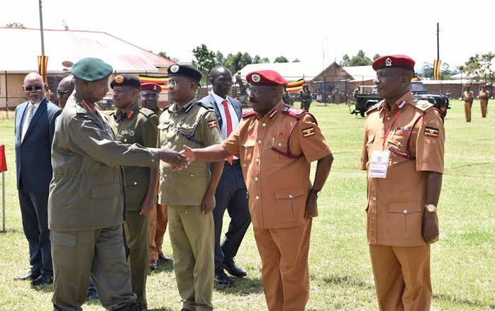 The Commissioner General of Prisons, Can. Dr. Johnson Byabashaija shakes hands with appointing authority, President Yoweri Museveni ( PHOTO/File)