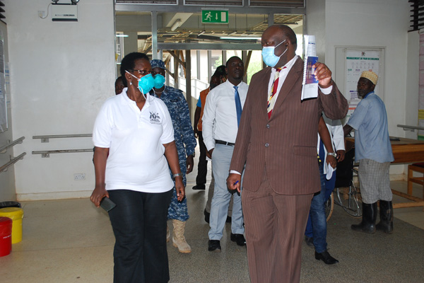 Masaka Regional Refferal Hospital Dr Nathan Onyachi (right) takes around Ministery of Health Permanent Secretary Dr Diana Atwine during her inspection of the facility