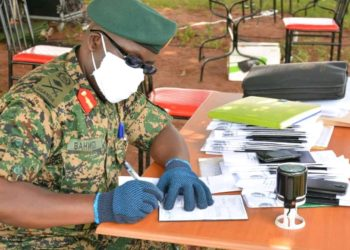 A UPDF officer registering