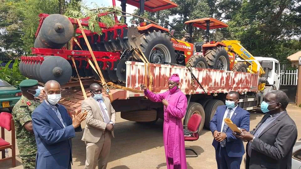 Archbishop Dr Stephen Samuel Kaziimba Mugalu receiving tractors on Tuesday (PHOTO/Courtesy).