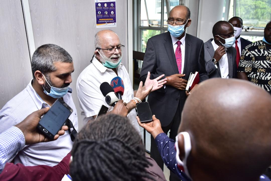 Mr Sudhir Ruparelia franked by his lawyer Peter Kabatsi of Kampala Associated Advocates, addresses the media after Court of appeal dismissed BoU's appeal in the Crane Bank saga (PHOTO/PML Daily).